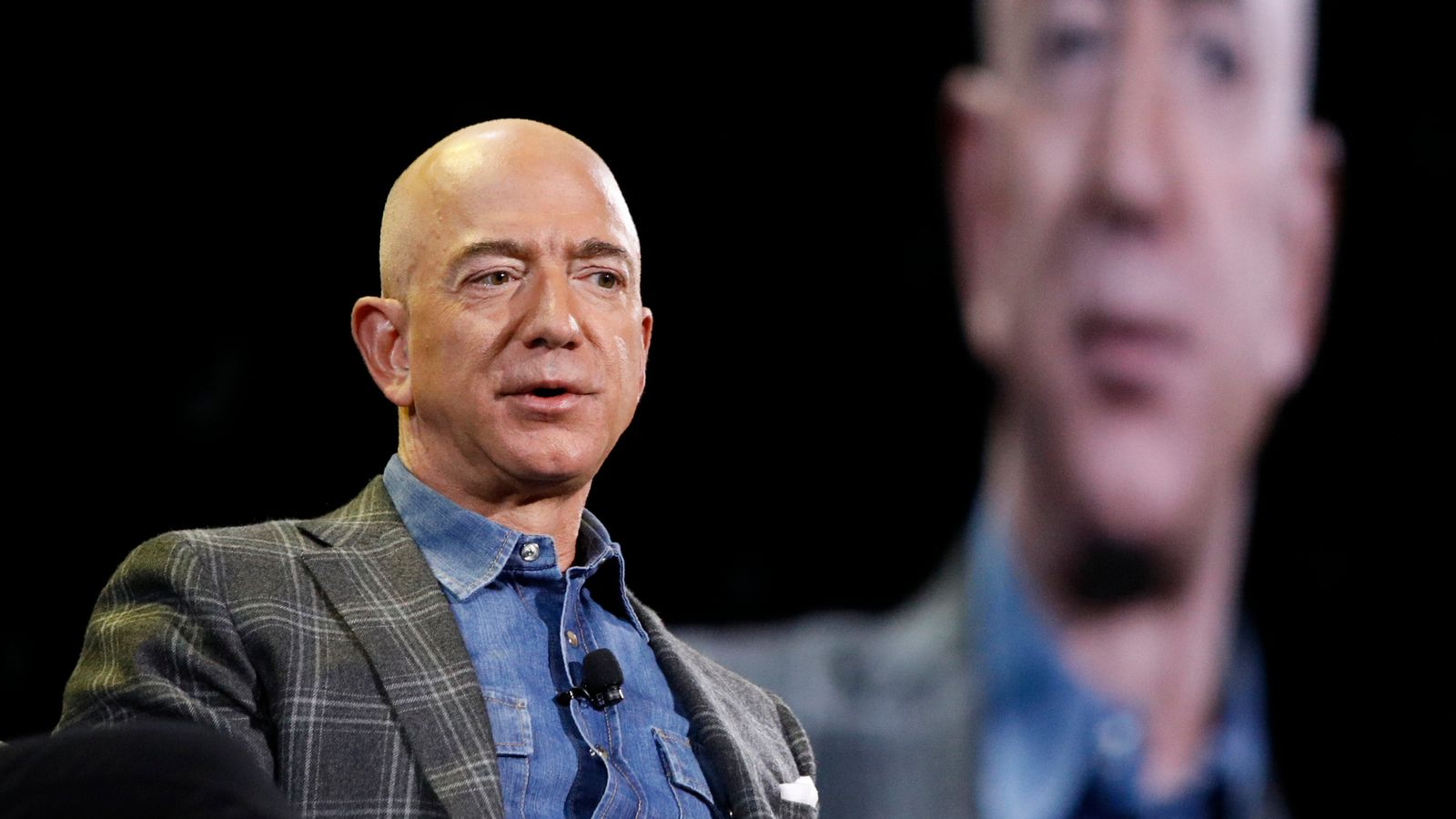 Amazon Chief Jeff Bezos To Travel Into Space Next Month For 'Adventure' With His Brother